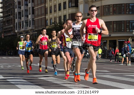 VALENCIA, SPAIN - November 16, 2014: Runners compete in the 2014 Valencia Marathon in Valencia, Spain. - stock photo