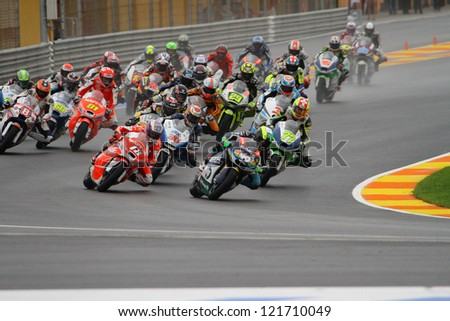 VALENCIA - SPAIN, NOVEMBER 11: Spanish rider Pol Espargaro wins the first corner at 2012 Generali MotoGP of Valencia on November 11, 2012 - stock photo