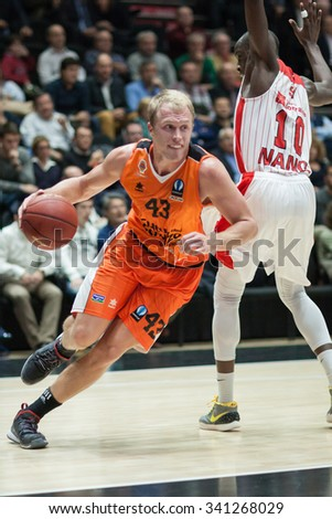 VALENCIA, SPAIN - NOVEMBER 18th: Sikma with ball (10) Sy during Eurocup between Valencia Basket Club and Sluc Nancy at Fonteta Stadium on November 18, 2015 in Valencia, Spain - stock photo