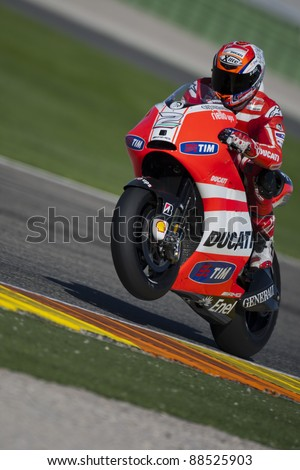 VALENCIA, SPAIN - NOVEMBER 9: Unreconized Test Rider of Ducati Team in the official motogp test with new 1.000cc engines, Ricardo Tormo Circuit of Cheste, Spain on november 9, 2011 - stock photo
