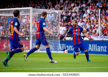 VALENCIA, SPAIN - OCT 22: Lionel Messi (right) celebrates a goal at the La Liga match between Valencia CF and FC Barcelona at Mestalla on October 22, 2016 in Valencia, Spain.