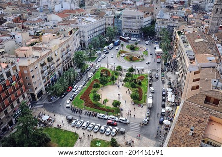 VALENCIA, SPAIN - OCTOBER 15, 2013: Center of the city - Plaza de la Reina. Located in the old town area this square has many cafes and restaurants and very popular among tourists