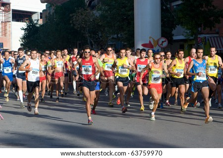 VALENCIA, SPAIN - OCTOBER 24: Runners compete in the XIII Gran Fondo de Manises run on October 24, 2010 in Valencia, Spain. - stock photo