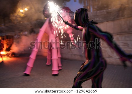 VALENCIA, SPAIN - OCTOBER 9: Street fiesta on October 9, 2010 in Valencia, Spain. October 9 is Day of Valencian Community, regional holiday celebrated annually with parades and fireworks.