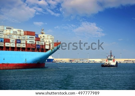 VALENCIA, SPAIN - october 02. The big container ship MAERSK TUKANG is leaving Valencia with the help of the tugs VB Conqueridor and VB Furia, on October 02, 2016 in Valencia.