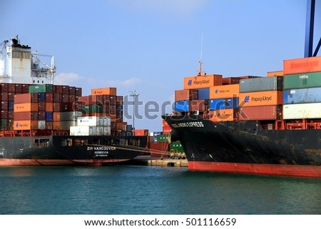 VALENCIA, SPAIN - october 02. The big container ship ZIM VANCOUVER and the RIO DE JANEIRO EXPRESS waiting docked for download his  containers in Valencia harbor, on October 02, 2016 in Valencia.