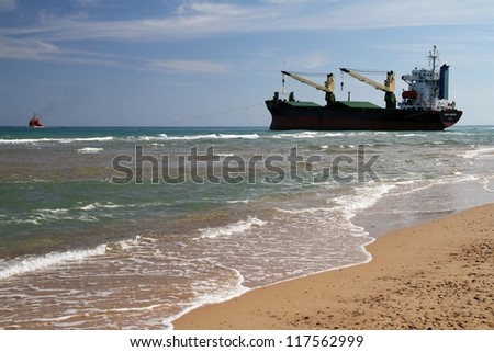 VALENCIA, SPAIN - OCTOBER 01: The cargo ship BSLE SUNRISE is aground on El Saler Beach after the strong storm when the boat was anchored close to Valencia port, on october 01, 2012 in Valencia.
