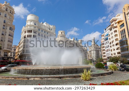 VALENCIA, SPAIN-SENTYABR 13, 2013: Fountain on one of the central streets of Valencia. Valencia - the third by number of inhabitants the city of Spain after Madrid and Barcelona. - stock photo