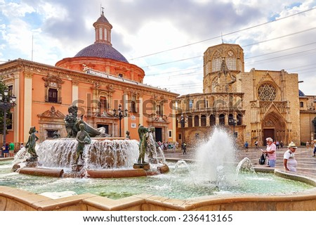 VALENCIA,SPAIN -SEPT 10:Square of Saint Mary's and fountain Rio Turia. September 10, 2014 in Valencia. Every year,Valencia(third size population  city in Spain)welcomes more than 4 million visitors.   - stock photo
