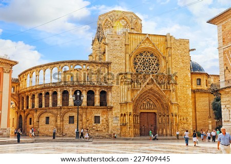 VALENCIA, SPAIN - SEPT 10: Square of Saint Mary's and Valencia  Cathedral Temple in old town. Every year,Valencia(third size population  city in Spain)welcomes more than 4 million visitors.   - stock photo