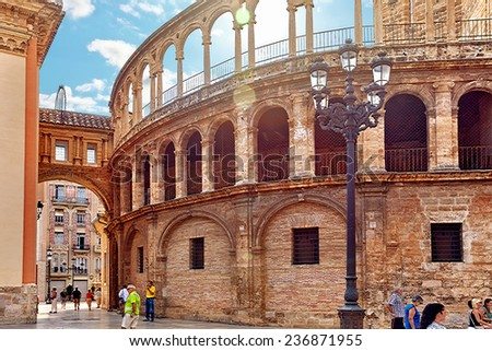 VALENCIA, SPAIN -SEPT 10: Square of Saint Mary's and Valencia -Temple in old town. September 10, 2014 in Valencia. Every year,Valencia(third size city in Spain)welcomes more than 4 million visitors.   - stock photo