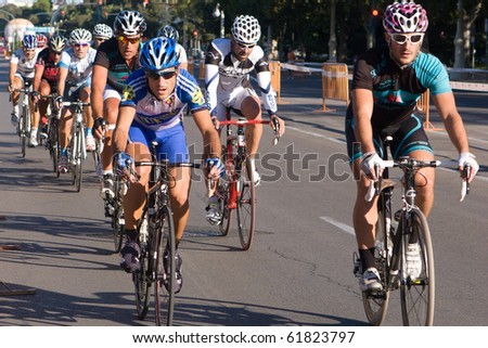 VALENCIA, SPAIN - SEPT 26: Unidentified riders participate in the XI City of Valencia Cycling Event on September 26, 2010 in Valencia, Spain. - stock photo