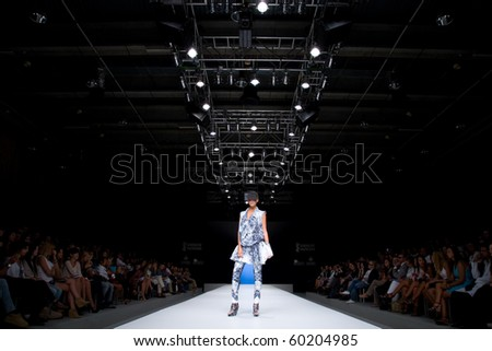 VALENCIA, SPAIN - SEPTEMBER 1: A model on the catwalk wears a Zazo & Brull design for the Valencia Fashion Week on September 1, 2010 in Valencia, Spain. - stock photo