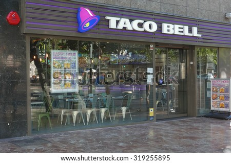 VALENCIA, SPAIN - SEPTEMBER 20, 2015: A Taco Bell fast-food restaurant in downtown Valencia. Taco Bell serves more than 2 billion customers each year in more than 5,800 restaurants.