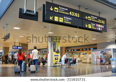 VALENCIA, SPAIN - SEPTEMBER 12, 2015: Airline passengers inside the Valencia Airport. About 4.59 million passengers passed through the airport in 2014. - stock photo