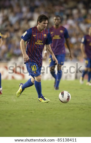 VALENCIA, SPAIN - SEPTEMBER 21: Messi in the Spanish Soccer League between Valencia C.F. vs F.C. Barcelona - Mestalla Luis Casanova Stadium - Spain on September 21, 2011 - stock photo