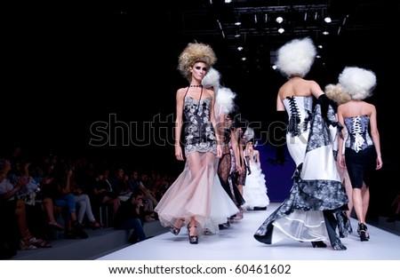 VALENCIA, SPAIN - SEPTEMBER 1: models on the catwalk wear Maya Hansen design for the Valencia Fashion Week on September 1, 2010 in Valencia, Spain. - stock photo