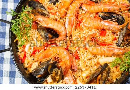 Valencian paella delicious seafood rice and prawns - stock photo