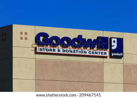 VALENICA, CA/USA - AUGUST 5, 2014: Goodwill store exterior sign. Goodwill Industries is a nonprofit organization that provides job training programs for people with disabilities. - stock photo