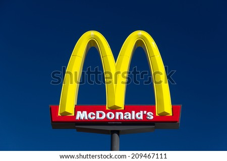 VALENICA, CA/USA - AUGUST 5, 2014: McDonald's restauraunt sign. The McDonald's Corporation is the world's largest chain of hamburger fast food restaurants. - stock photo