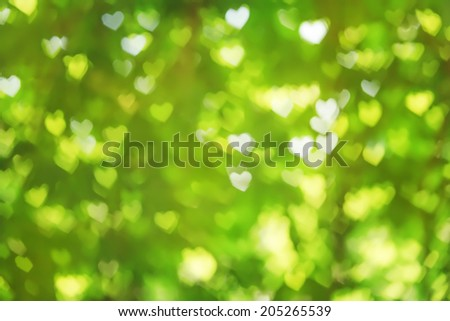 Valentine abstract green background with heart bokeh. - stock photo