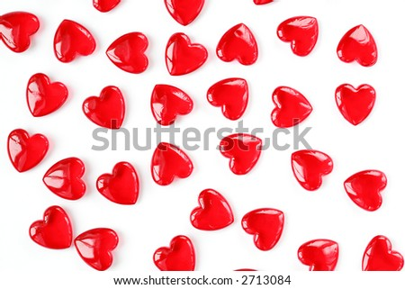 Valentine background of small red hearts on white