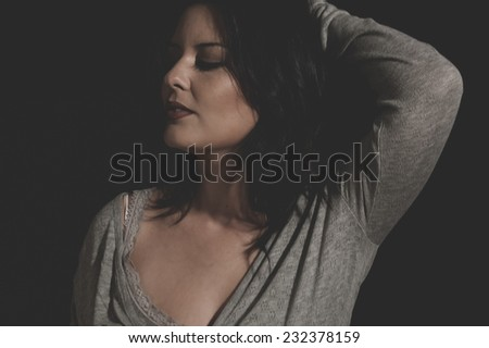 valentine, beautiful young brunette with sexy appearance, wearing a thin sweater gray - stock photo