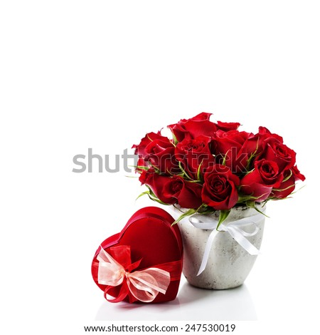 Valentine composition with roses and gift box over white - stock photo