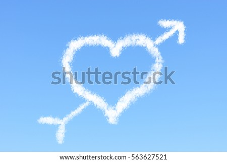Valentine concept heart shaped cloud and arrow with clear blue sky
