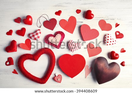 Valentine concept. Variety of hearts on wooden table background
