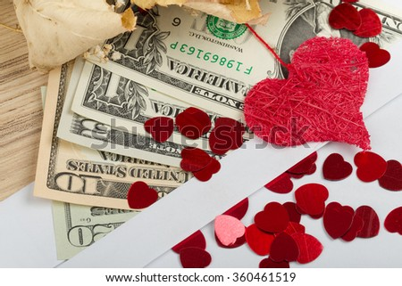 valentine concept with hearts, dry roses and us dollar banknotes as valentine present - stock photo