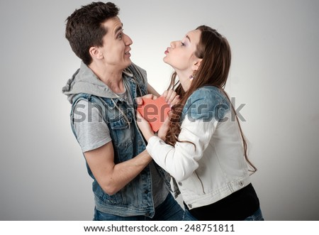 Valentine Couple. Portrait of Beauty Girl and her Handsome Boyfriend. Happy Joyful Family. Love Concept. Heart Sign. Laughing Happy Lovers. Valentines Day - stock photo