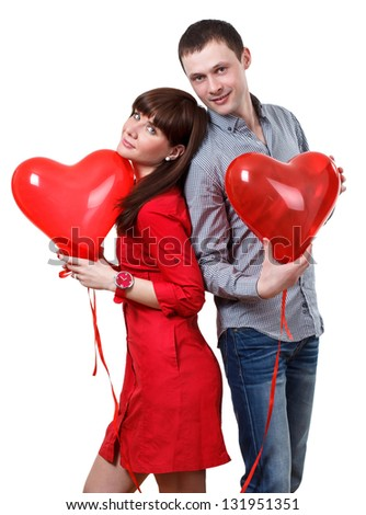 Valentine couple with red baloons hearts