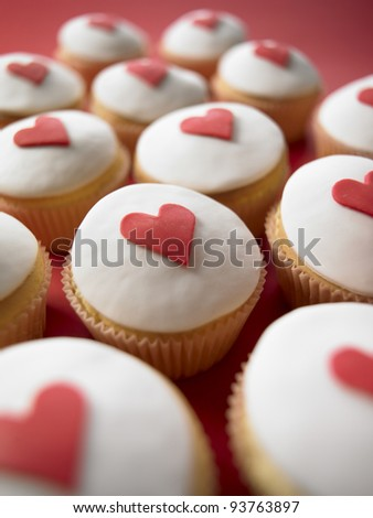 valentine cup cakes with hearts - stock photo