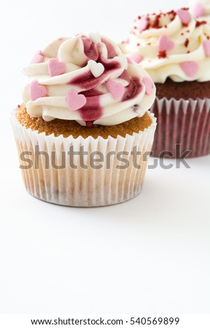 Valentine cupcakes decorated with sweet hearts isolated on white background.copyspace
