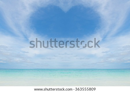 Valentine day background. Heart made from cloud and blue sky over beautiful white sand beach and clear blue sea of Ta Chai island, Andaman, Thailand Asia.. - stock photo