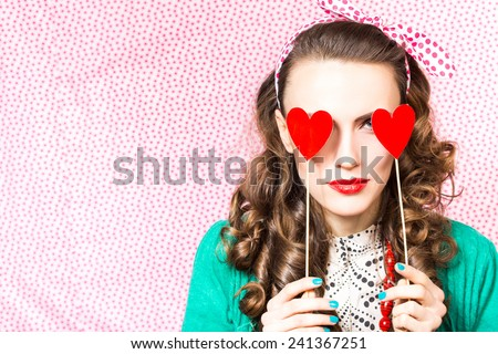 Valentine day. Beautiful woman holding red heart. studio shot - stock photo