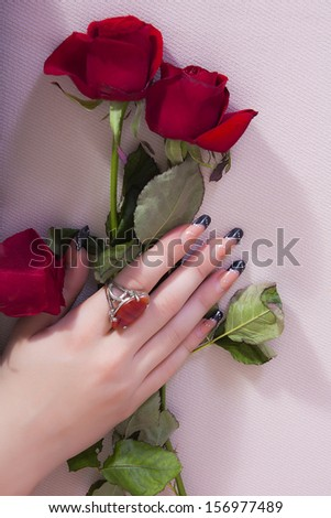 valentine day. close up of female hand holding flowers - stock photo