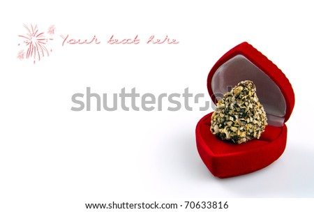 Valentine day concept: chocolate candy in red heart-shape gift-box. Macro shot, isolated on white background with copyspace