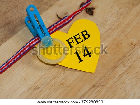 Valentine Day concept. Use condom for safety - stock photo