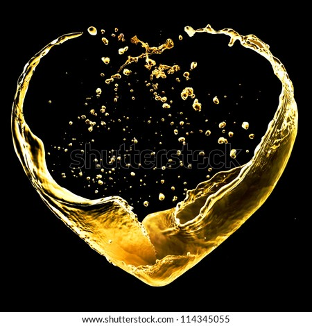 Valentine day heart made of gold splash isolated on black - stock photo