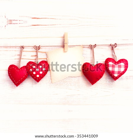 Valentine day love beautiful. Heart handmade and paper old mark hanging on rope on wooden background. - stock photo