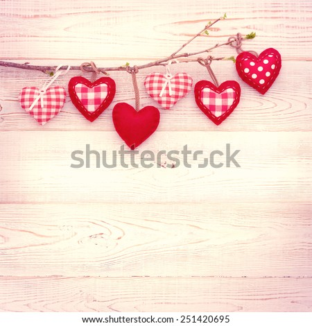 Valentine day love beautiful. Heart hanging on branch of tree on wooden background. - stock photo