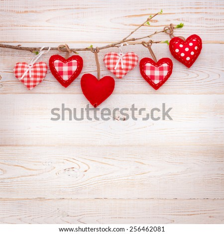 Valentine day love beautiful. Heart hanging on branch of tree on wooden background - stock photo