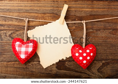 Valentine Day love beautiful. Valentines Vintage Handmade Hearts over Wooden Background. Valentine over Wood. Retro Styled Wallpaper. Valentines Day. Paper Tag labeling.  - stock photo