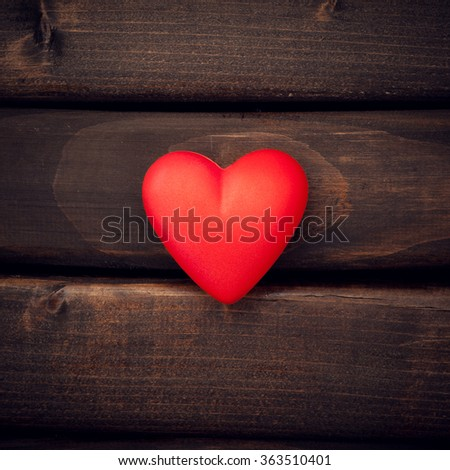 Valentine day. Red heart on the dark boards. Valentine's Day. Heart pendant. Red heart.  Space for text. Eighth of March. International Women's Day. Toned image. - stock photo