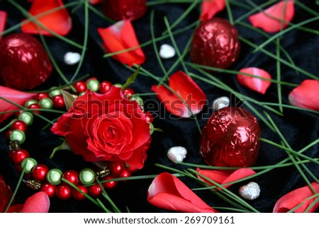 Valentine day rose with chocolates and pearls - stock photo