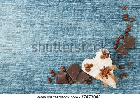 Valentine denim background, greeting card with original textile heart, coffee beans and chokolate. Handmade concept. Your text on the card. - stock photo