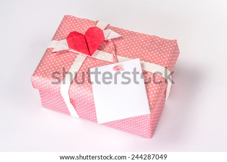 valentine gift box with paper heart and blank card - stock photo