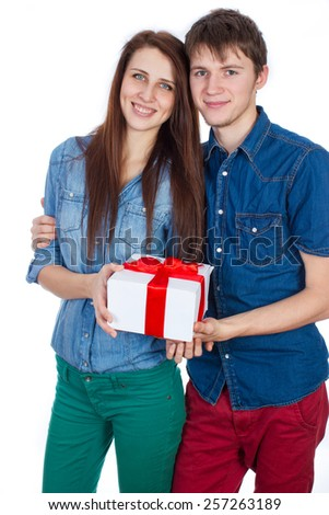 Valentine Gift. Happy Young beautiful Couple  isolated on a White background. Happy Man giving a gift to his Girlfriend. Holiday - stock photo